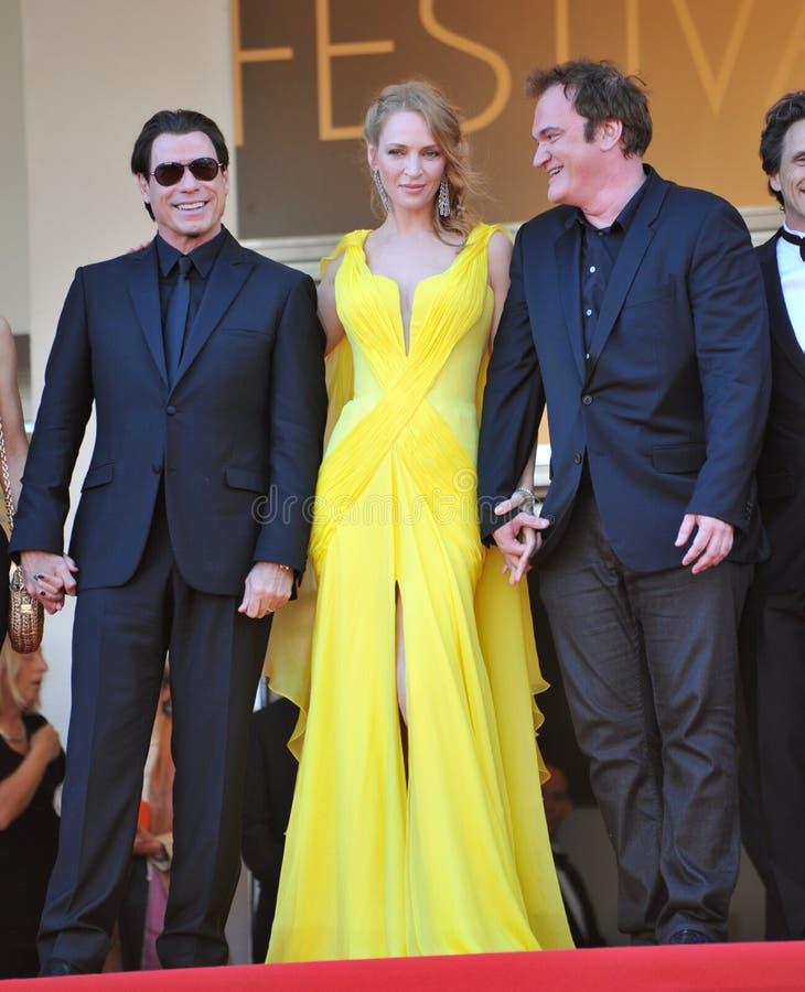 John Travolta et Uma Thurman et Quentin Tarantino photo libre de droits