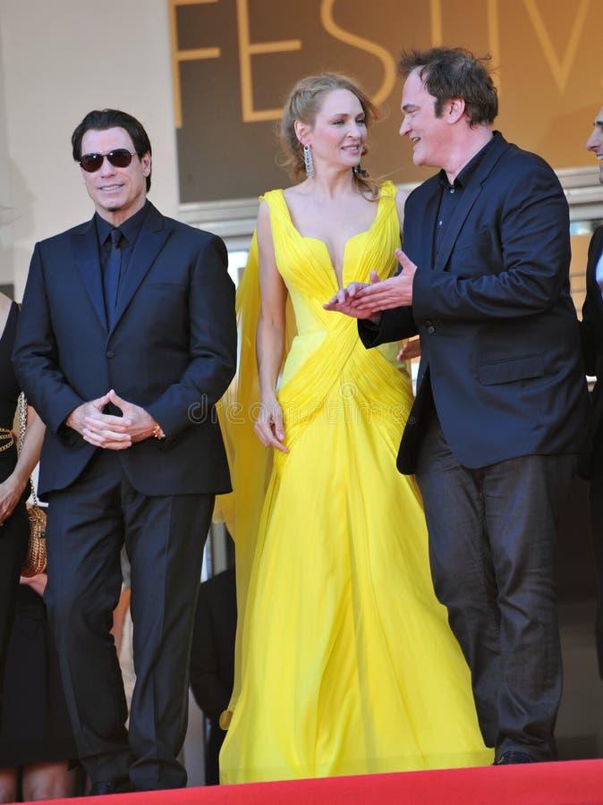 John Travolta & Uma Thurman & Quentin Tarantino. CANNES, FRANCE - MAY 23, 2014: John Travolta, Uma Thurman & director Quentin Tarantino at 20th anniversary stock image