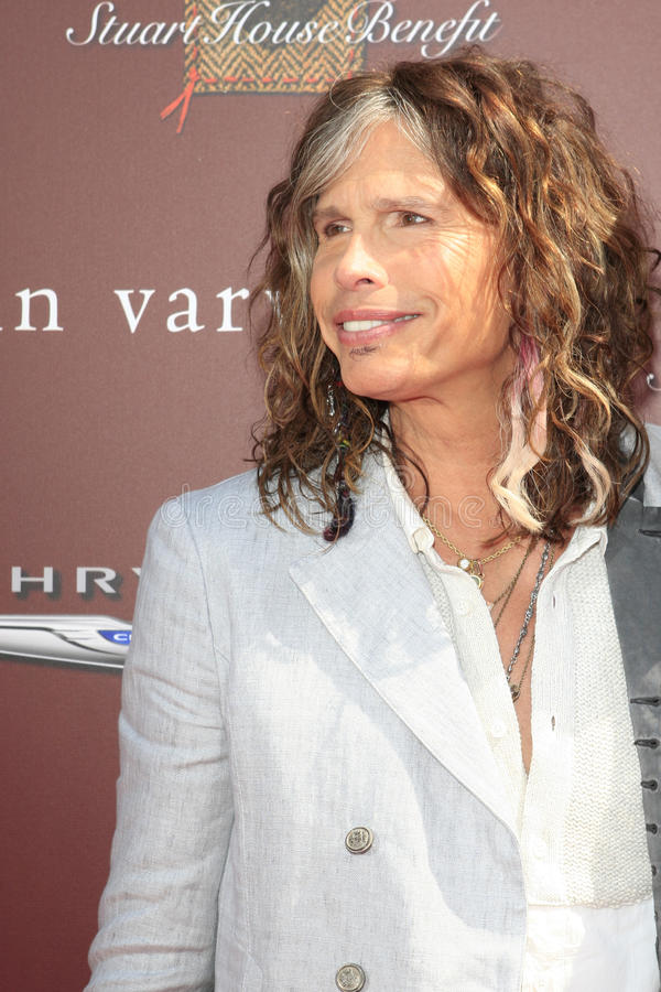 John Varvatos,Steven Tyler. LOS ANGELES - MAR 11: Steven Tyler arrives at the 9th Annual John Varvatos Stuart House Benefit at the John Varvatos Store on March royalty free stock photos