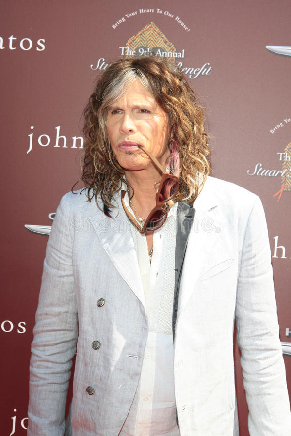 John Varvatos,Steven Tyler. LOS ANGELES - MAR 11: Steven Tyler arrives at the 9th Annual John Varvatos Stuart House Benefit at the John Varvatos Store on March royalty free stock images