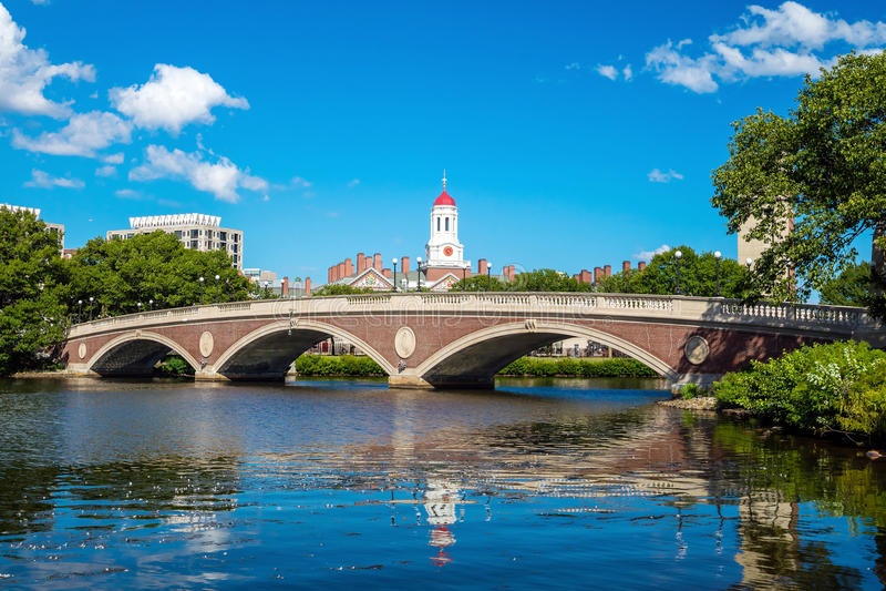 John W. Weeks Bridge with clock tower over Charles River. In Harvard University campus Boston royalty free stock photo