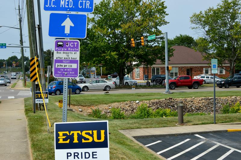 Signs and Traffic next to a Busy Street. Johnson City, Tennessee United States 08-25-2017 Signs and Traffic Next to a Busy Street royalty free stock photos