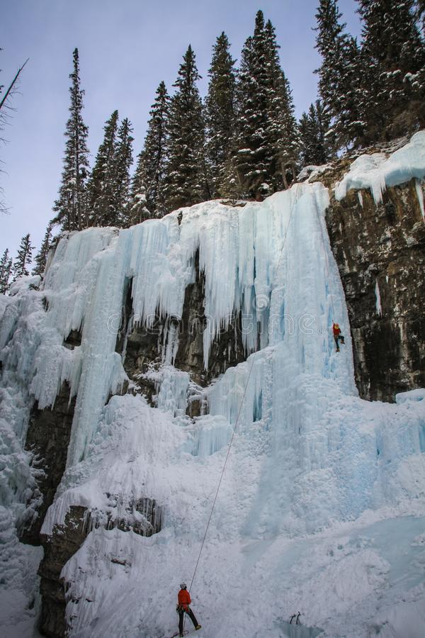 Johnston Canyon`s Upper falls with ice climbers , bow river, alberta Canada. During the winter months December to April, Johnston Canyon is a favourite place to royalty free stock photos