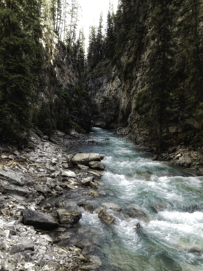 Johnston Canyon. Summertime at the waterfall Johnston Canyon in Banff National Park royalty free stock photo