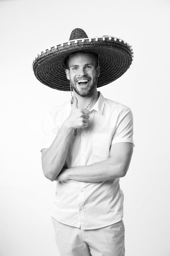 Joignez la célébration Le chapeau heureux de sombrero de visage d'homme montre le pouce vers le haut du fond de lumière de geste  photo libre de droits