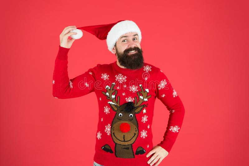 Join holiday celebration. Winter party outfit. Sweater with deer. Hipster bearded man wear winter clothes red background royalty free stock photo