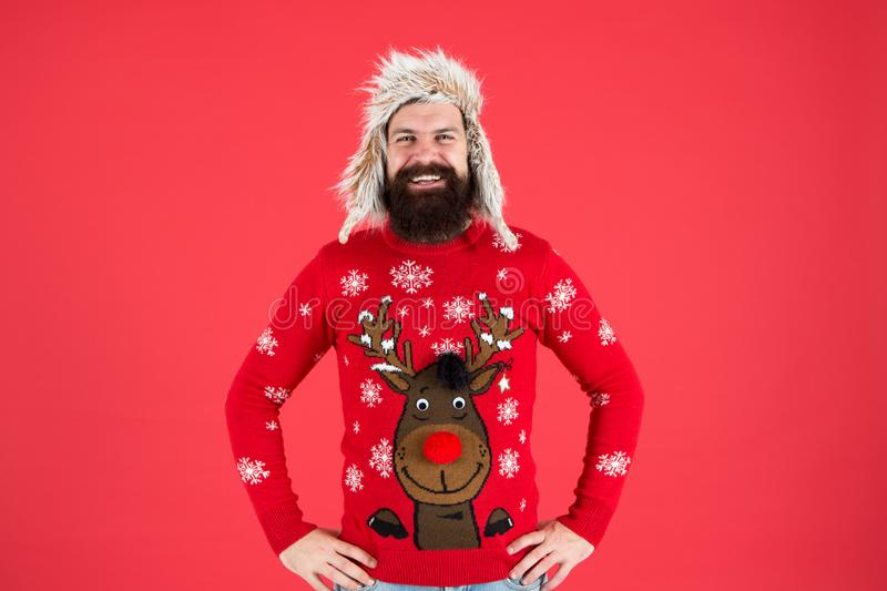 Join holiday party craze and host Ugly Christmas Sweater Party. Sweater with deer. Hipster bearded man wear winter royalty free stock image