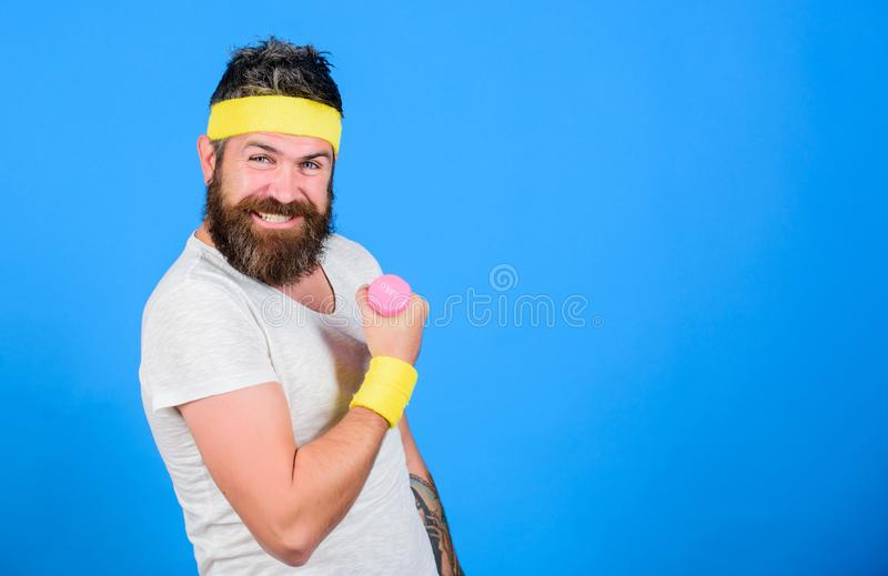 Join my sport class. Athlete training with cute dumbbell. Man bearded athlete exercising dumbbell. If you want to be. Strong. Motivated athlete guy. Sportsman royalty free stock image