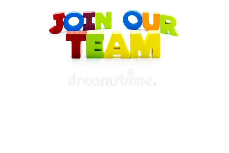 Join Our Team text written with colourful wooden letters, isolated over white with copy space stock image