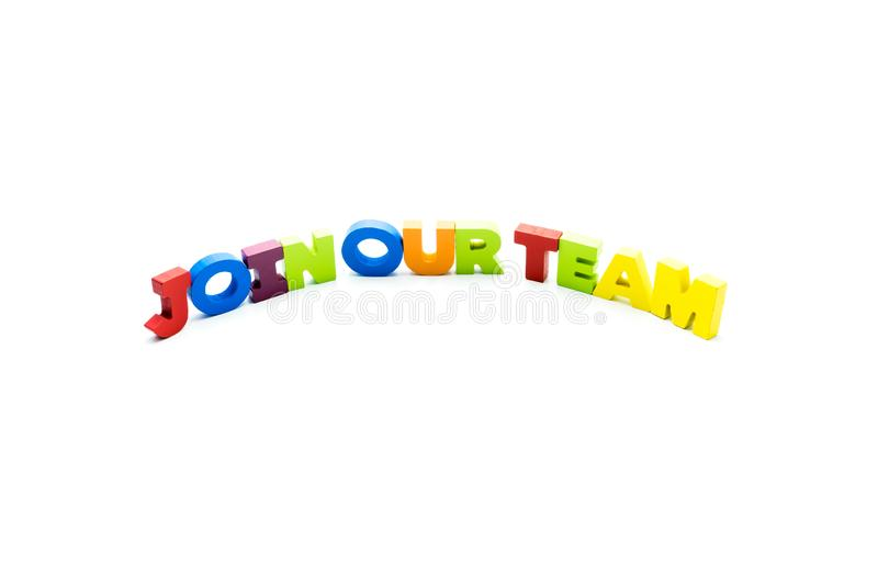 Join Our Team text written with colourful wooden letters, isolated over white with copy space stock photography
