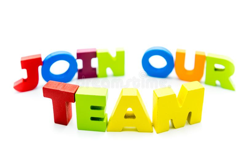 Join Our Team text written with colourful wooden letters, over white with copy space stock photo
