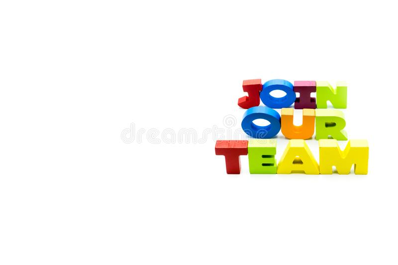 Join Our Team text written with colourful wooden letters, isolated over white with copy space on the left hand side stock images