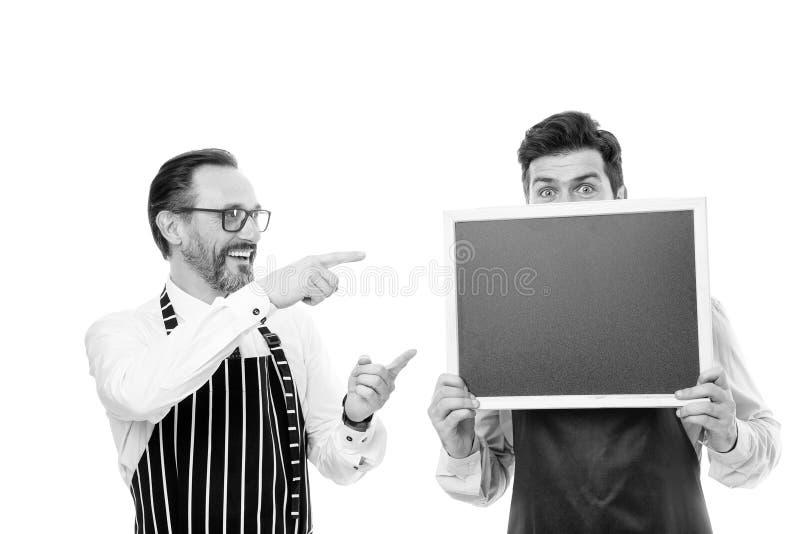 Join us. Hiring restaurant staff. Hipster bartender show blackboard copy space. Men bearded informing. Men bearded royalty free stock image