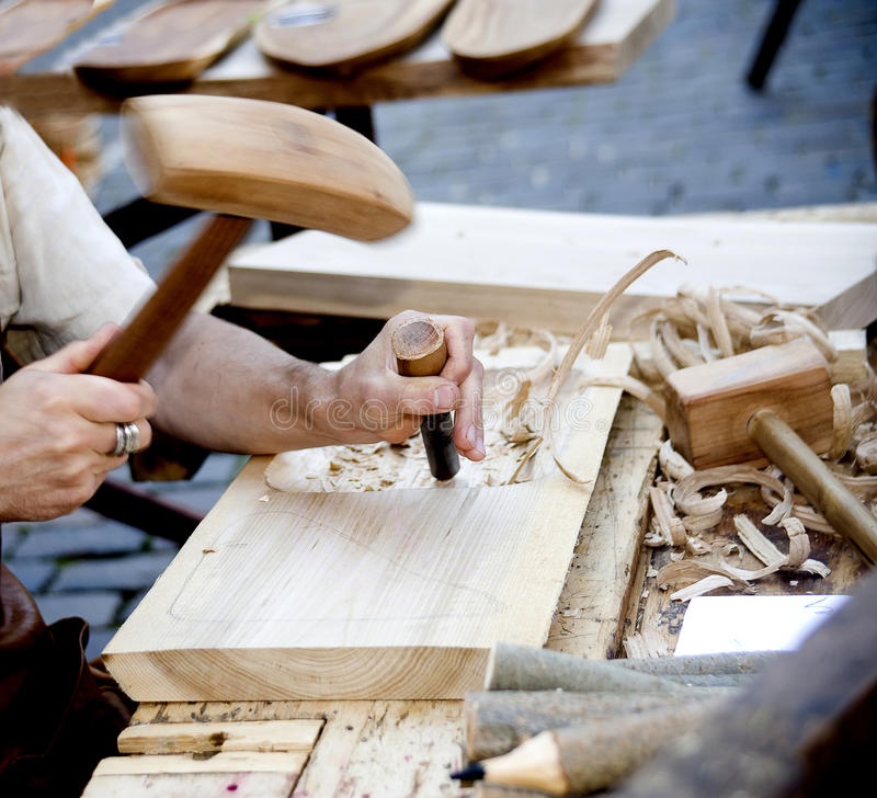 The joiner does a dimple in a board,. Working with a chisel royalty free stock photos
