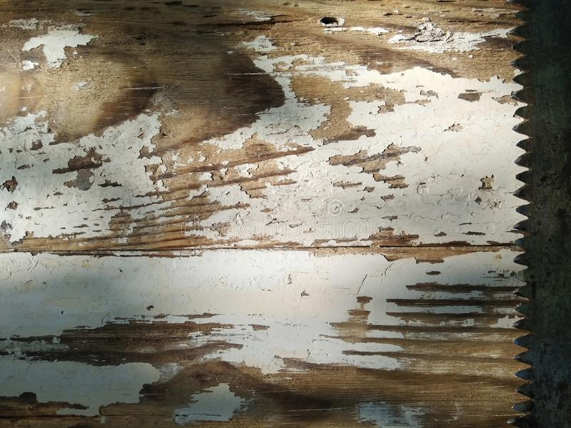 Joiner`s background. Old saw and shabby wood stock photos
