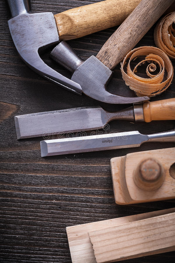 JoinerÂ's tools and curled shavings on vintage wood. Board construction concept royalty free stock photography