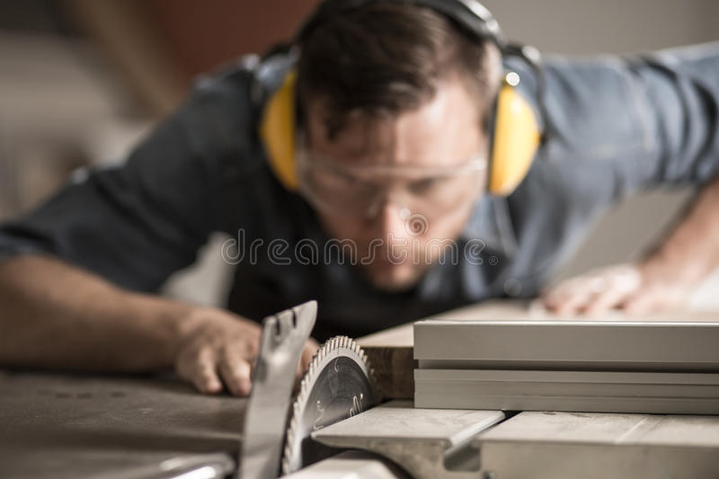 Joiner sawing wood royalty free stock photos