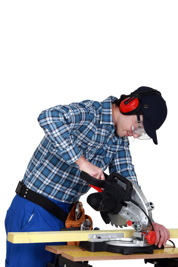 Joiner at work. With workbench and machine stock photo