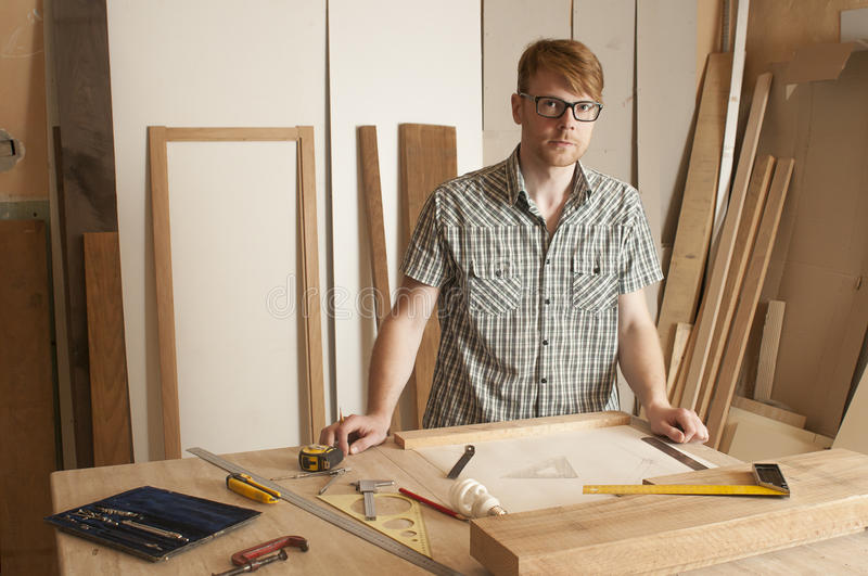 Joiner. The young joiner works on the drawing of a new product stock photography