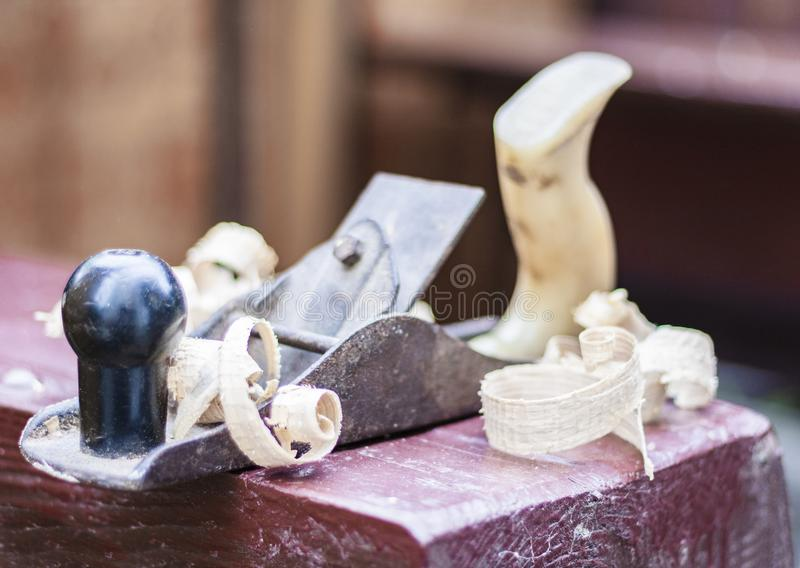 Joinery – old wooden plane and chips in a workshop of the carpenter royalty free stock images