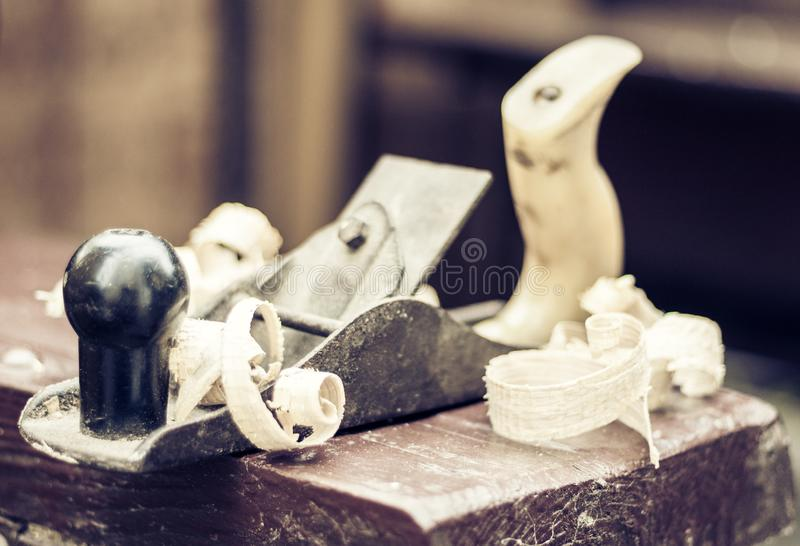 Joinery – old wooden plane and chips in a workshop of the carpenter, retro concept stock photo