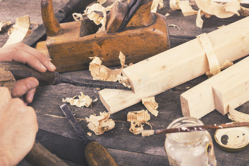 Joinery - carving the wood with chisel. On the table royalty free stock photography