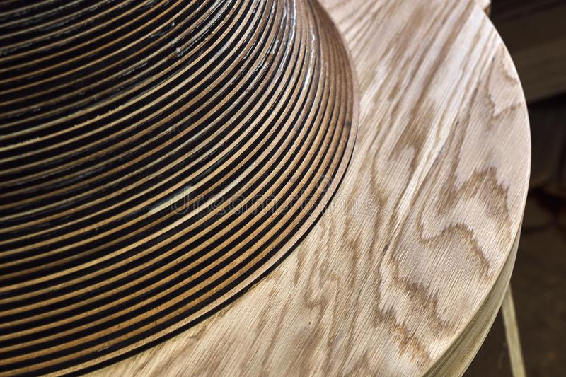 Joinery. Creative round shape coffee table made of mdf and natural wood. Joinery. Wooden coffee table in shape of circle being produced in workshop stock photography