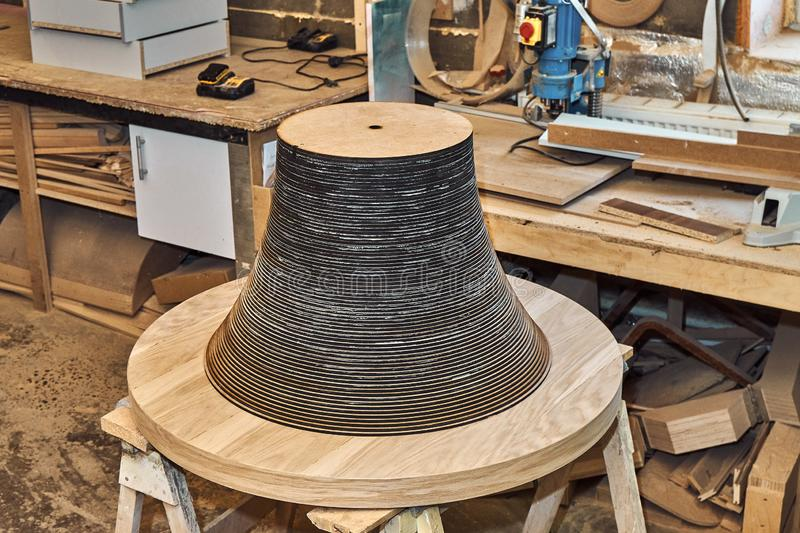 Joinery. Creative round shape coffee table made of mdf and natural wood. Joinery. Wooden coffee table in shape of circle being produced in workshop stock photos