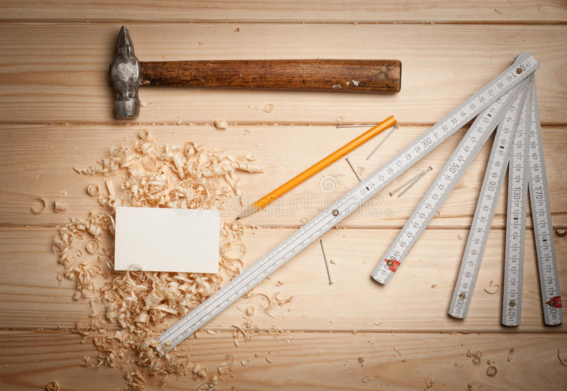 Joinery tools on wood table background with. Business card and copy space royalty free stock photo