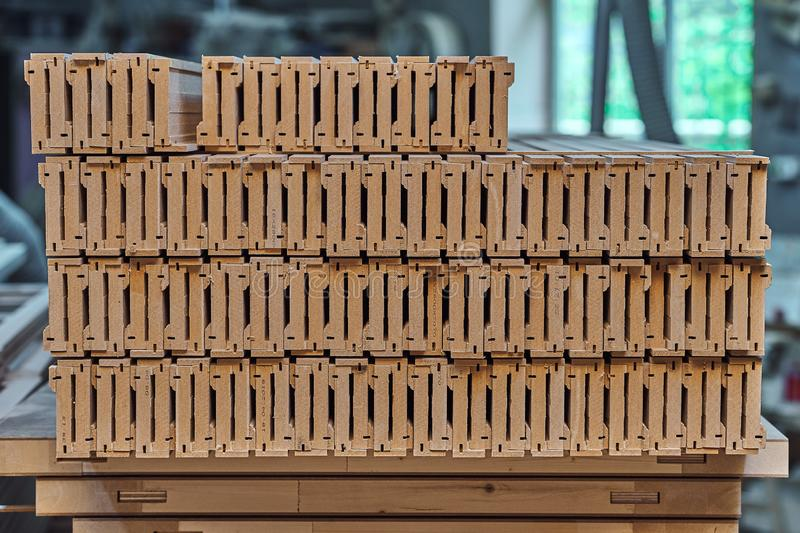 Joinery. Wood door manufacturing process. Stacked door architraves. Furniture manufacture. Joinery. Wood door manufacturing process. Stacked door architraves stock image