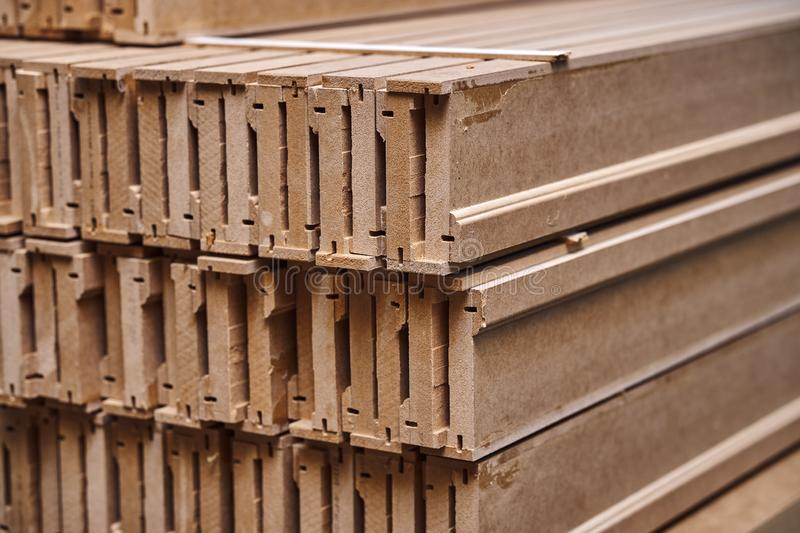 Joinery. Wood door manufacturing process. Stacked door architraves. Furniture manufacture. Joinery. Wood door manufacturing process. Stacked door architraves royalty free stock image