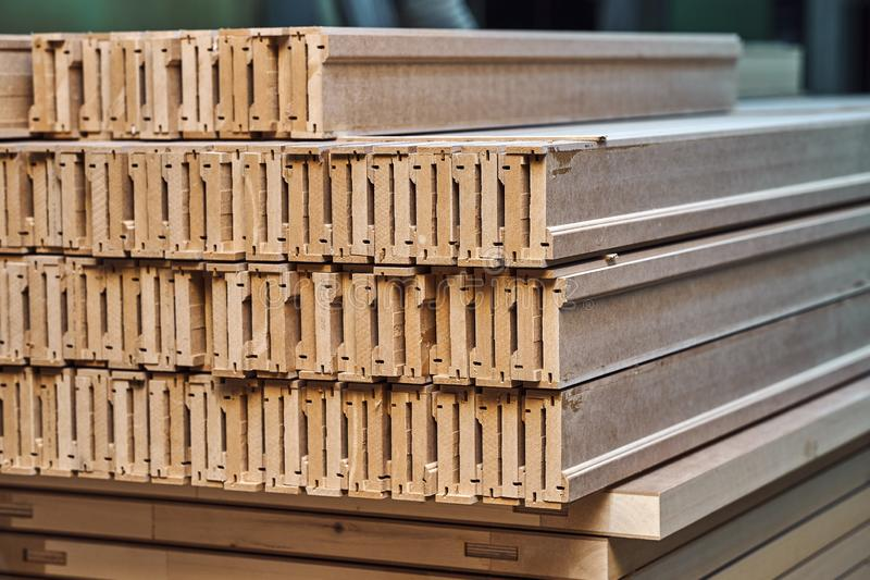 Joinery. Wood door manufacturing process. Stacked door architraves. Furniture manufacture. Joinery. Wood door manufacturing process. Stacked door architraves stock photo