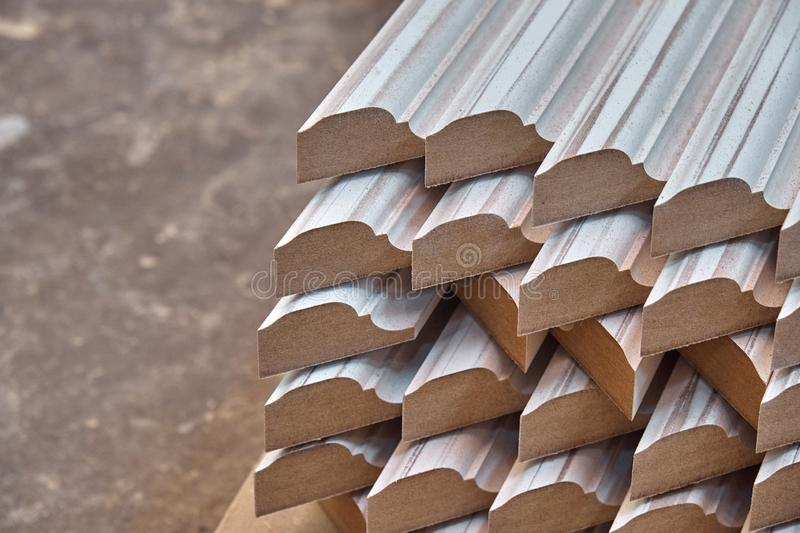 Joinery. Wood door manufacturing process. Stacked door moldings. Furniture manufacture. Joinery. Wood door manufacturing process. Stacked door moldings royalty free stock photo
