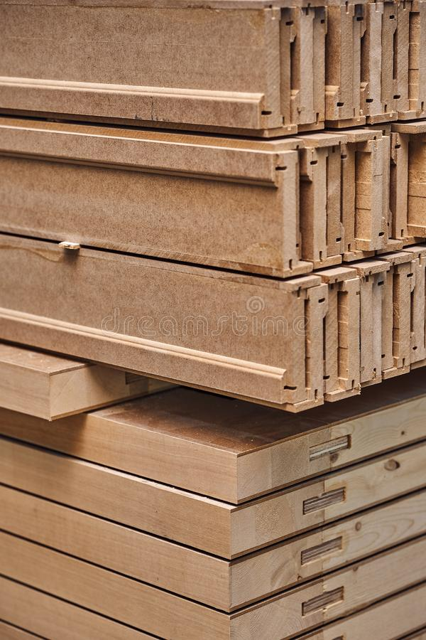 Joinery. Wood door manufacturing process. Stacked door leafs and architraves. Furniture manufacture. Joinery. Wood door manufacturing process. Stacked door leafs stock photos