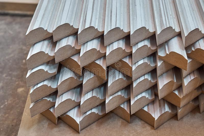 Joinery. Wood door manufacturing process. Stacked door moldings. Furniture manufacture. Joinery. Wood door manufacturing process. Stacked door moldings stock photos