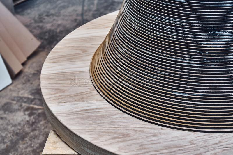 Joinery. Creative round shape coffee table made of mdf and natural wood. Joinery. Wooden coffee table in shape of circle being produced in workshop royalty free stock photos