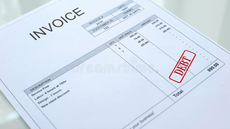 Joint de dette embouti sur le document de facture, le paiement d'affaires, les prêts et les crédits photo libre de droits