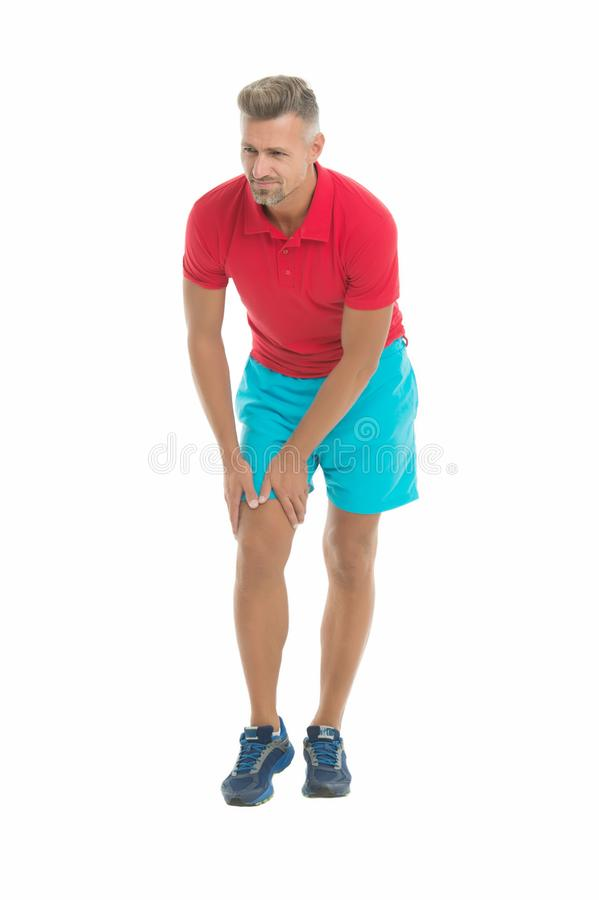 Joints care. Sportsman with knee pain on white background. Man suffer from pain. Health problem. Sport injury. Medical royalty free stock images