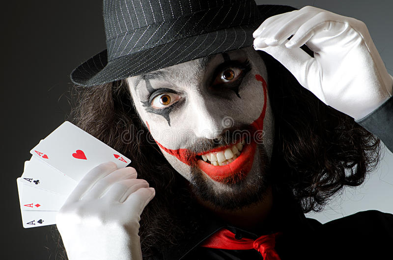 Joker with cards in studio stock photos