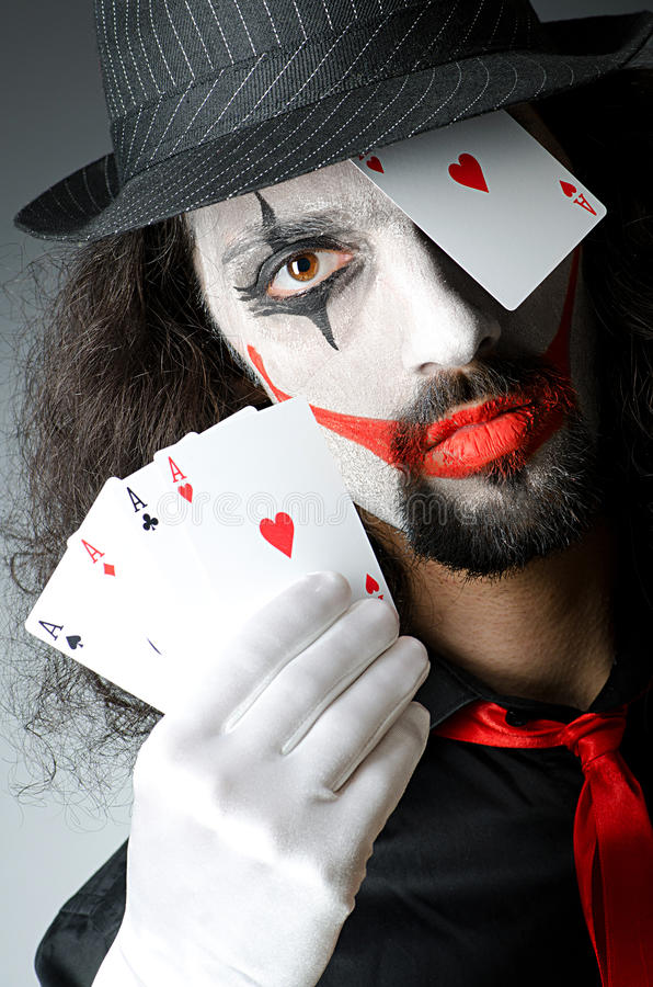 Joker with cards in studio royalty free stock photography