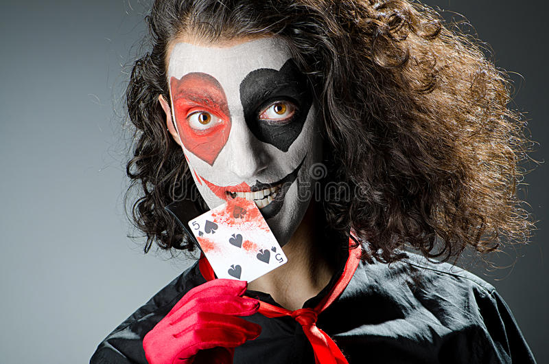 Joker With Face Mask Stock Photography