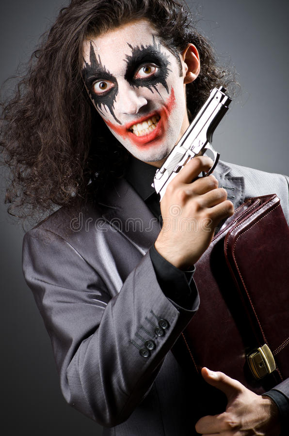 Joker with gun stock images