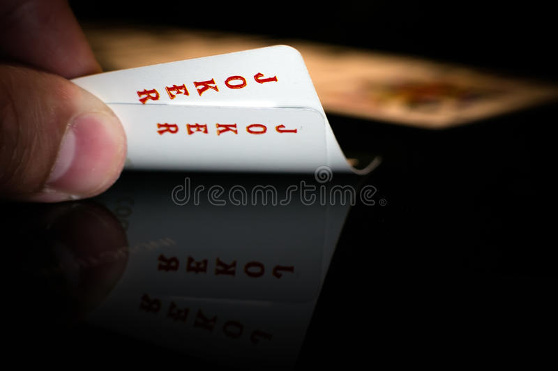 Joker in hand stock photography