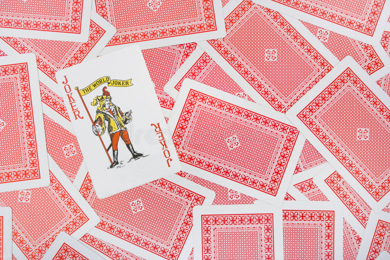 Joker on playing cards royalty free stock photography