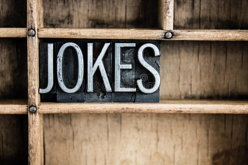 Jokes Concept Metal Letterpress Word in Drawer. The word JOKES written in vintage metal letterpress type in a wooden drawer with dividers stock images