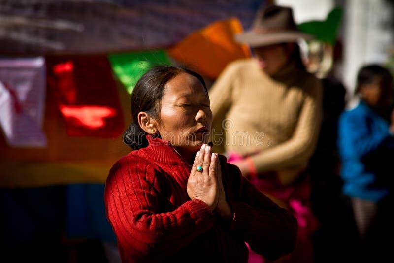 Jokhang Temple and Barkhor Square praying woman Lhasa Tibet royalty free stock photography