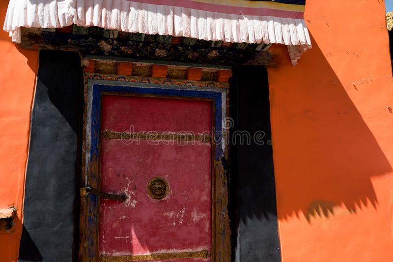 Jokhang Temple Door Lhasa Tibet. Jokhang Temple ('House of the Lord') in Lhasa is the holiest site in Tibetan Buddhism, attracting crowds of prostrating Tibetan stock photography