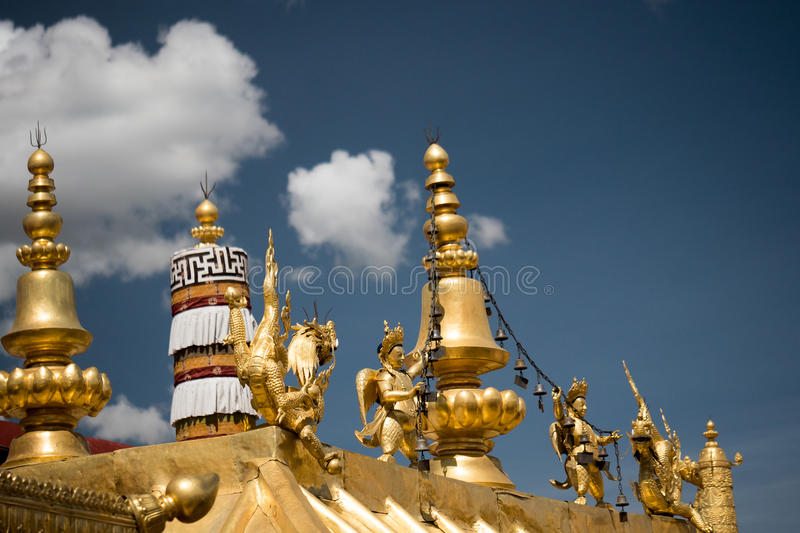 Jokhang Temple Golden Roof Lhasa Tibet. Jokhang Temple ('House of the Lord') in Lhasa is the holiest site in Tibetan Buddhism, attracting crowds of prostrating royalty free stock photography