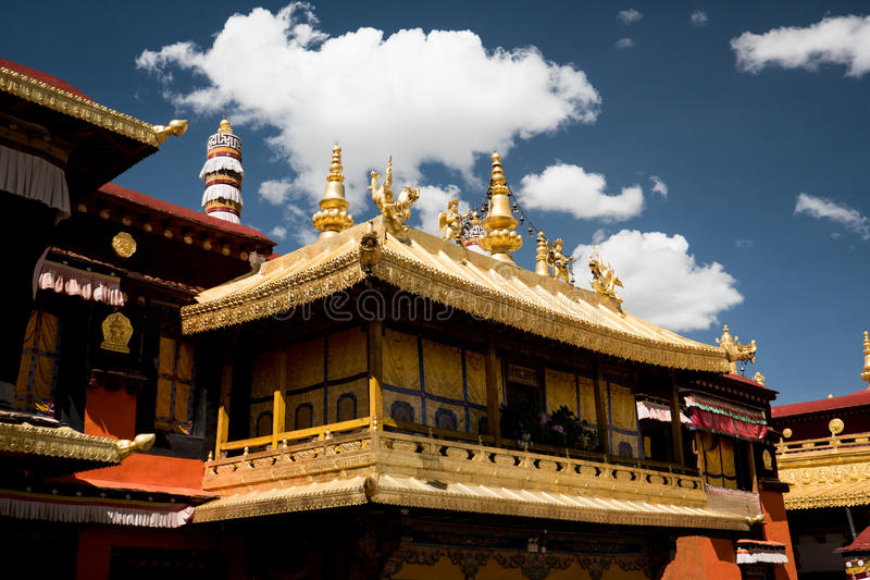 Jokhang Temple Roof Lhasa Tibet. Jokhang Temple ('House of the Lord') in Lhasa is the holiest site in Tibetan Buddhism, attracting crowds of prostrating Tibetan stock image