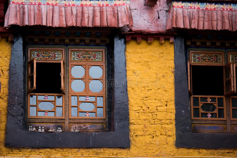 Jokhang Temple wall Lhasa Tibet. Jokhang Temple ('House of the Lord') in Lhasa is the holiest site in Tibetan Buddhism, attracting crowds of prostrating Tibetan stock photo